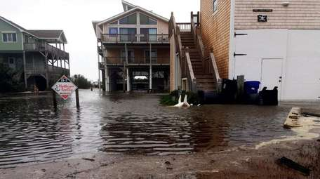 Floodwaters surround homes as Hurricane Maria moves closer