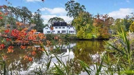The two-acre property in Bayport features a private