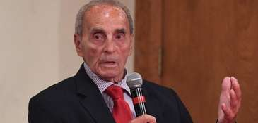 Patrick Vecchio speaks during a debate held by