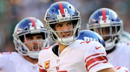 Eli Manning of the Giants reacts  against the