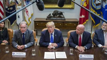 President Donald Trump meets with members of the