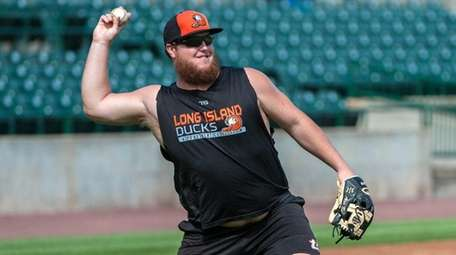 Ducks pitcher Matt Larkins works out at Bethpage Ballpark on
