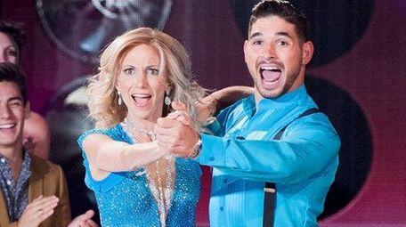 Debbie Gibson and partner Alan Bersten dance a