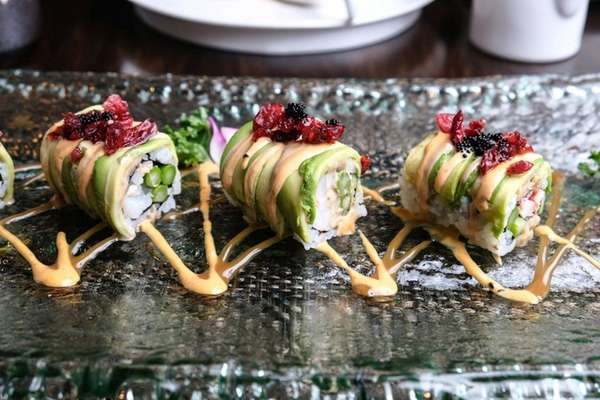 A Black Pearl sushi roll stuffed with asparagus