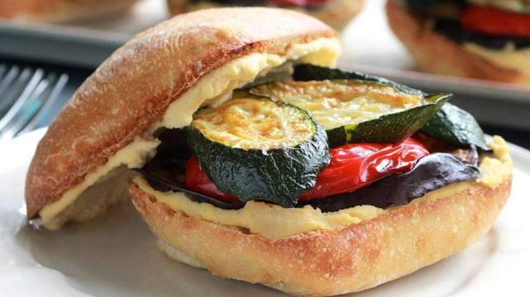 Roasted eggplant, zucchini and bell pepper are sandwiched