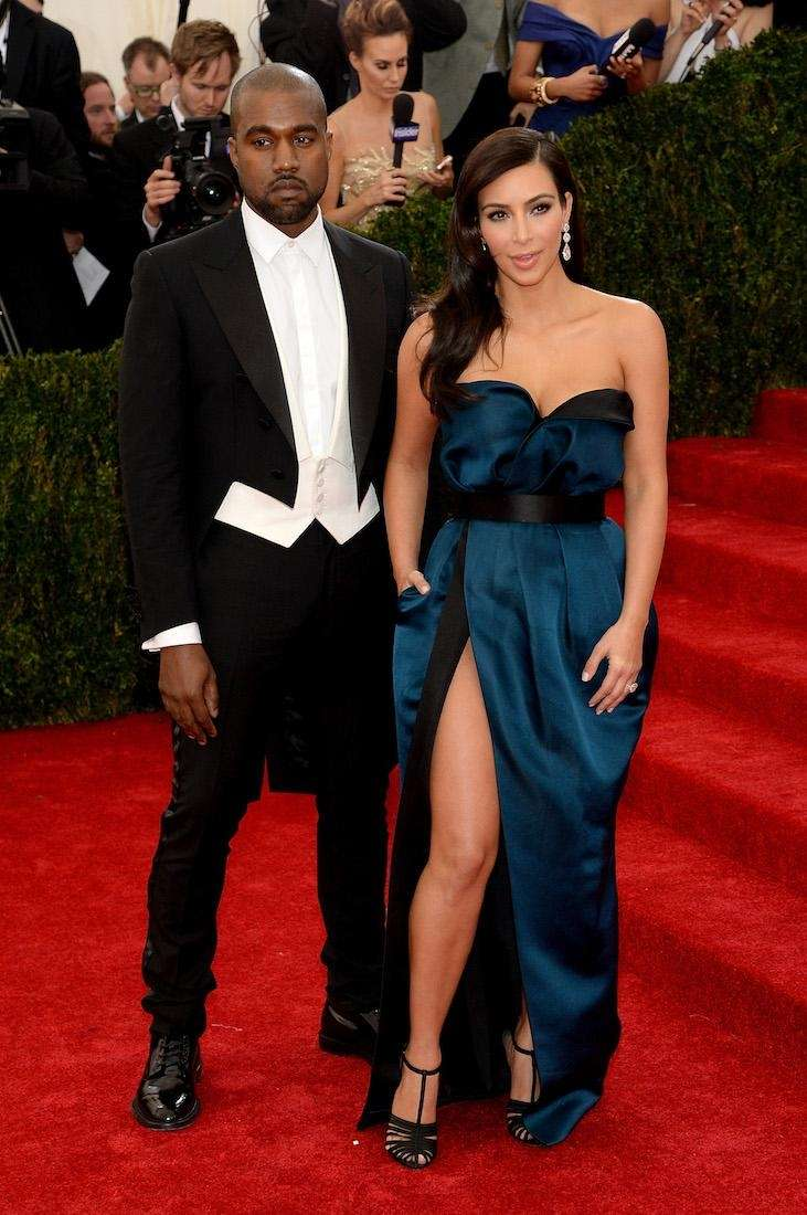 Kanye West and Kim Kardashian attend the Charles