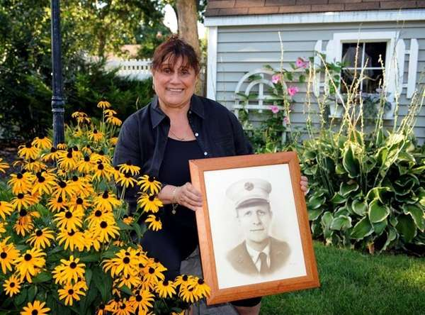 JoAnn Cross displays a portrait of her late