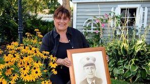 JoAnn Cross displays a portrait of her late