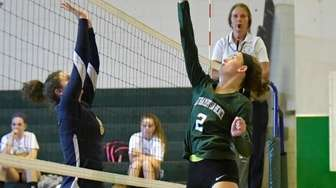 Westhampton's Emma Marino hits the ball past Shoreham-Wading