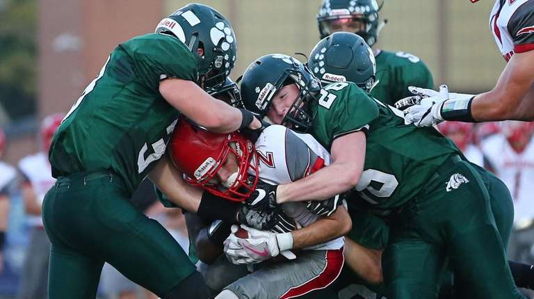 Corey Voorneveld of Lindenhurst tackles G.Q. Grippo of