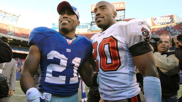 Tiki Barber of the Giants greets his brother Ronde Barber