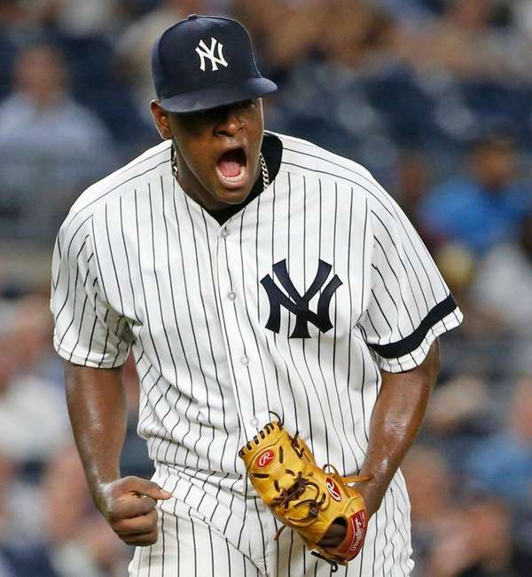 Yankees starting pitcher Luis Severino reacts after theRays'