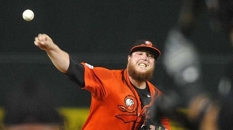 Ducks starting pitcher Matt Larkins delivers to Revolution