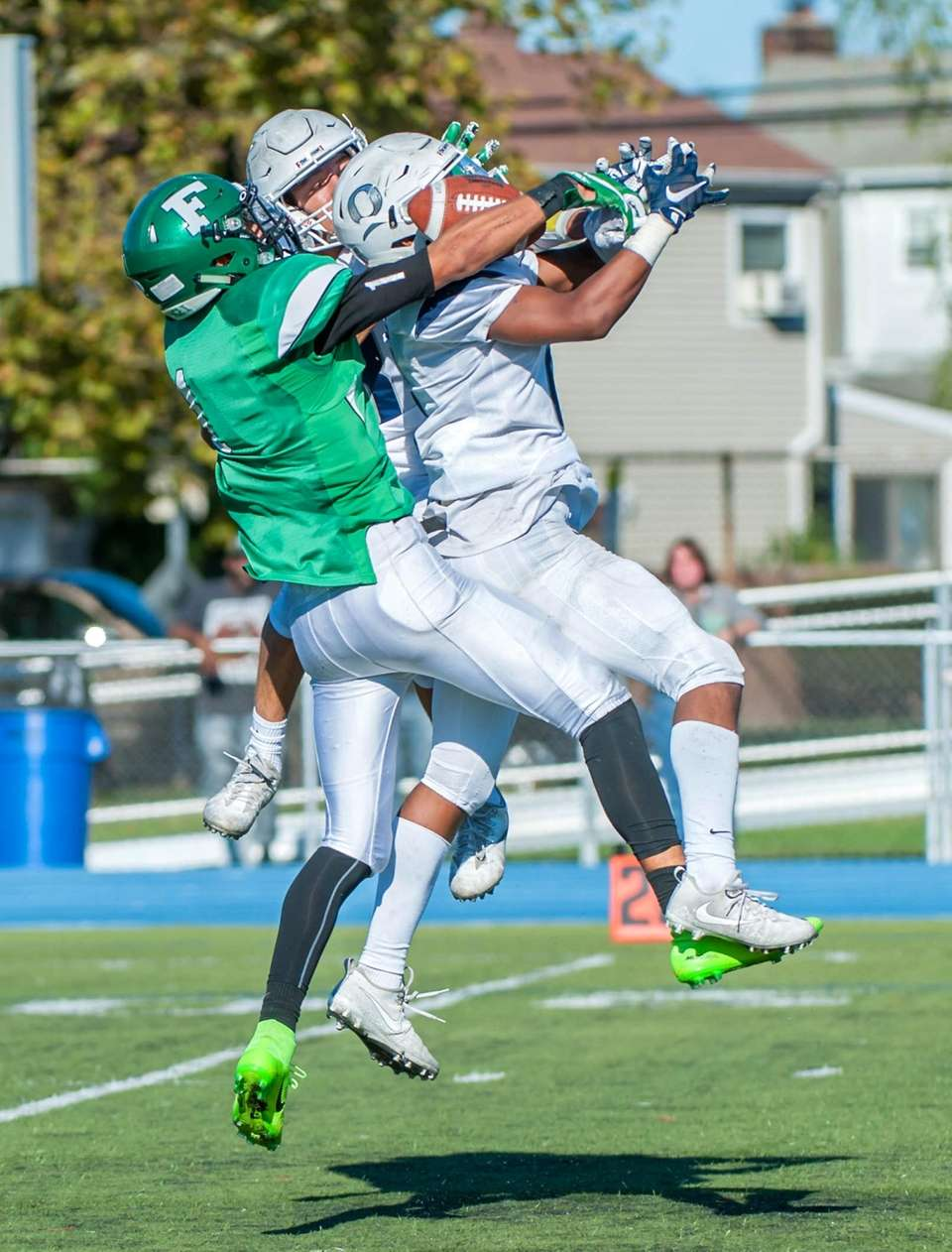 Oceanside's John Natoli (center rear) and Alijah James