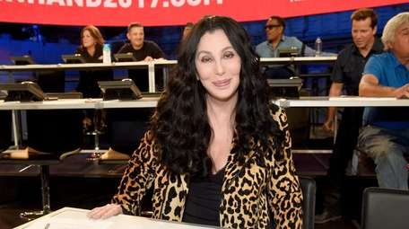 Cher helps out during the star-studded telethon Hand