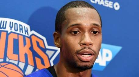 Lance Thomas speaks to the media aftertraining camp