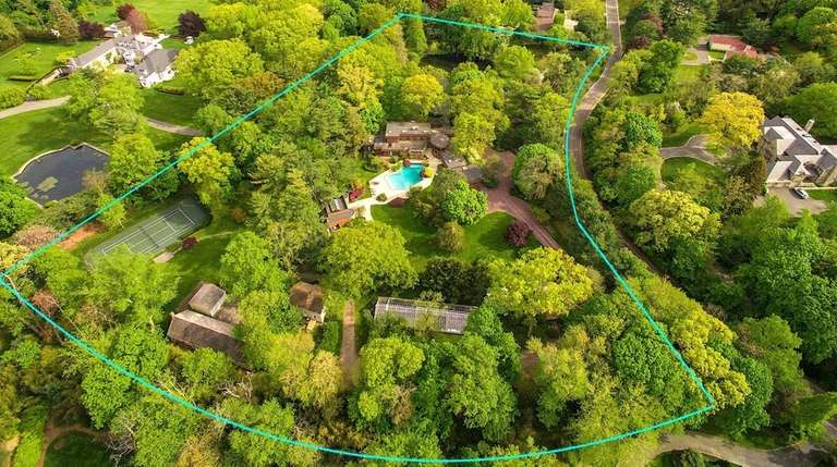 The 6-acre plus Old Westbury property comes with