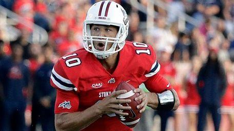 Stony Brook quarterback Joe Carbone rolls left to