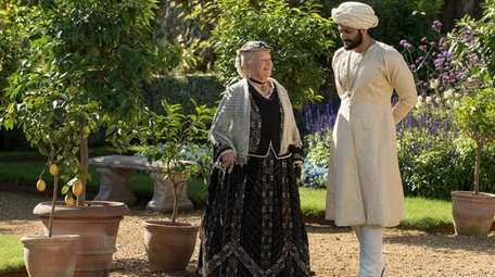 Judi Dench and Ali Fazal in