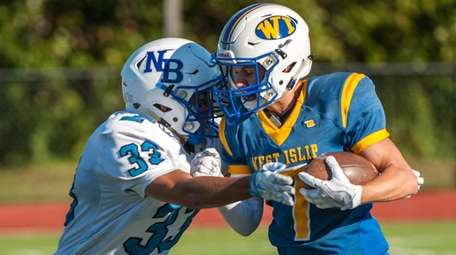 North Babylon's Joe Gelosi, left, tries to tackle