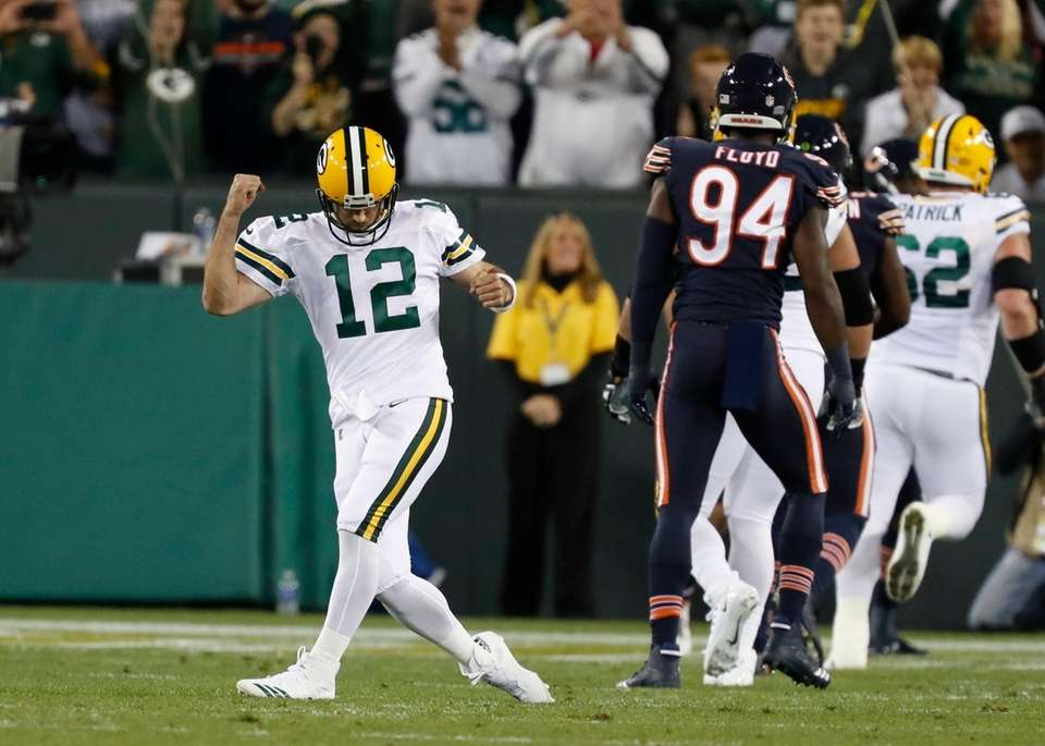 Green Bay Packers' Aaron Rodgers celebrates a touchdown