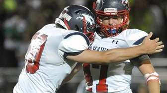 Petey Striano of Cold Spring Harbor, right, gets