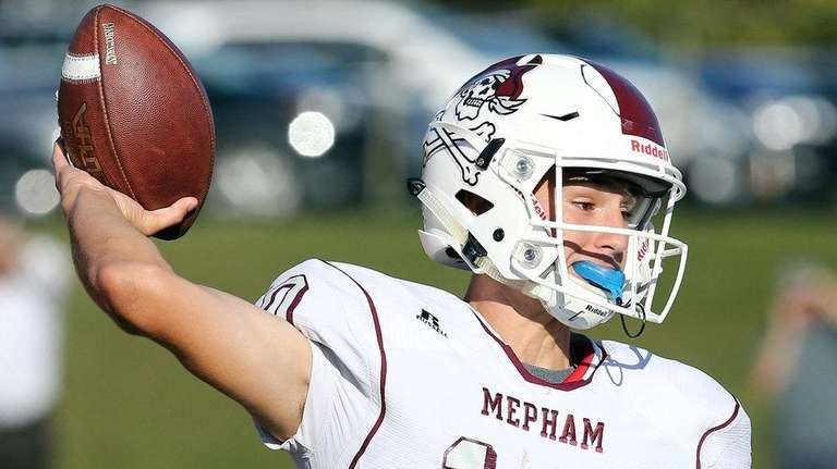 Mepham QB Michael Proios passes against Carey on Sept.