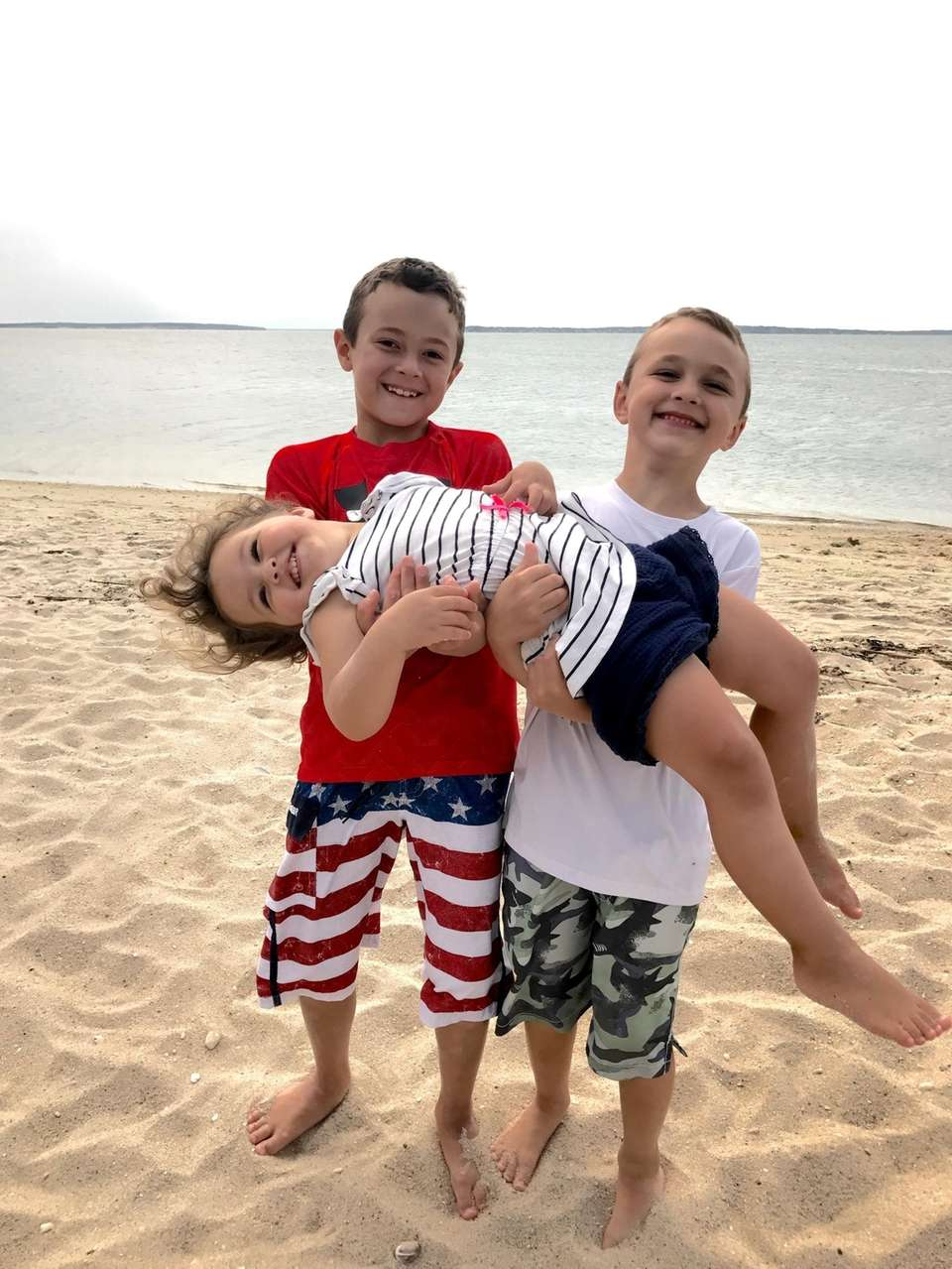 My three children goofing around at the beach