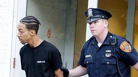 Rape suspect Marcus Johnson, a teacher's aide at