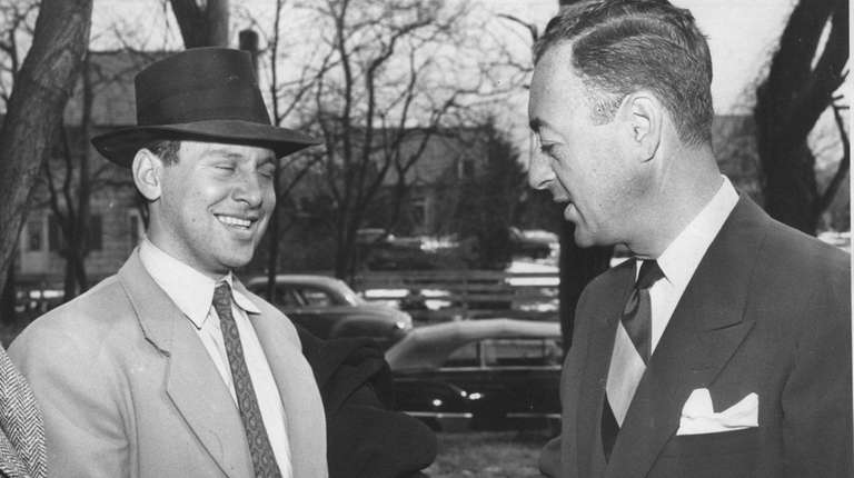 Builder William Levitt, right, congratulates Mortimer Weiss of