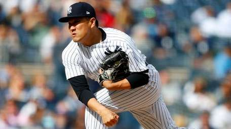 Masahiro Tanaka pitches against the Toronto Blue Jays