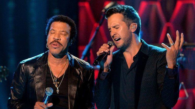 Lionel Richie, left, and Luke Bryan perform