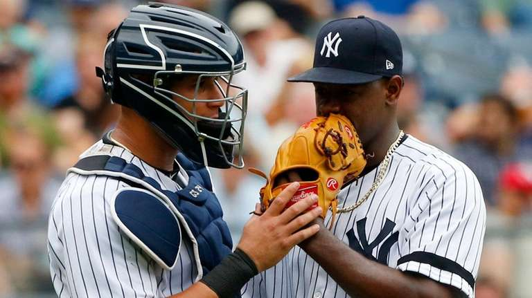 Gary Sanchez  talks with Luis Severino in the third