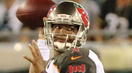 Jameis Winston of the Bucs attempts a pass