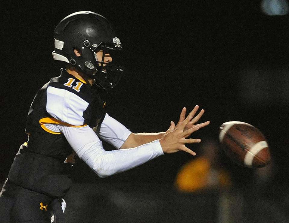 Gregory Campisi, St. Anthony's quarterback, takes a snap