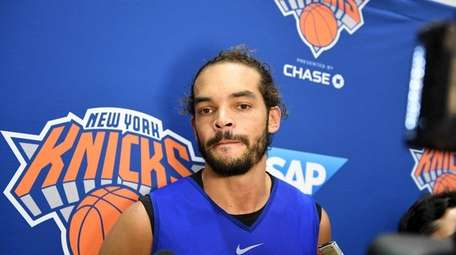 Joakim Noah speaking to the media after practice