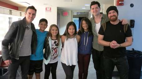 Kidsday reporters from Jericho with band members of
