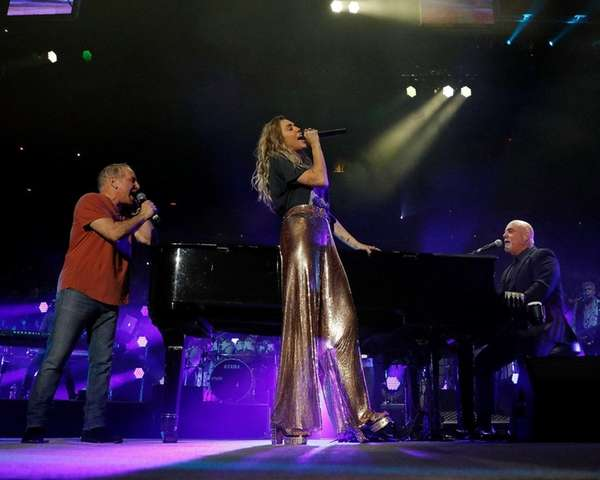 Billy Joel performs with suprise guests Paul Simon