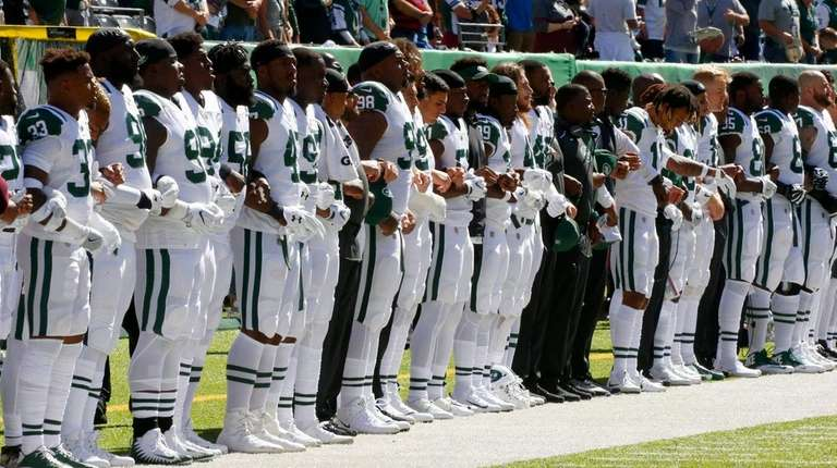The Jets stand during the national anthem prior