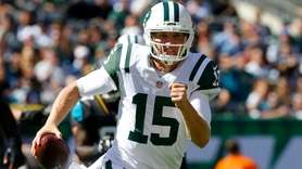 Josh McCown of the New York Jets runs
