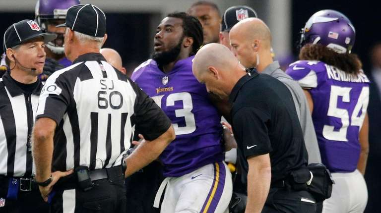 Vikings running back Dalvin Cook is helped off