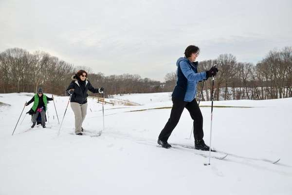 Phyllis Powers, right, of East Northport skis with