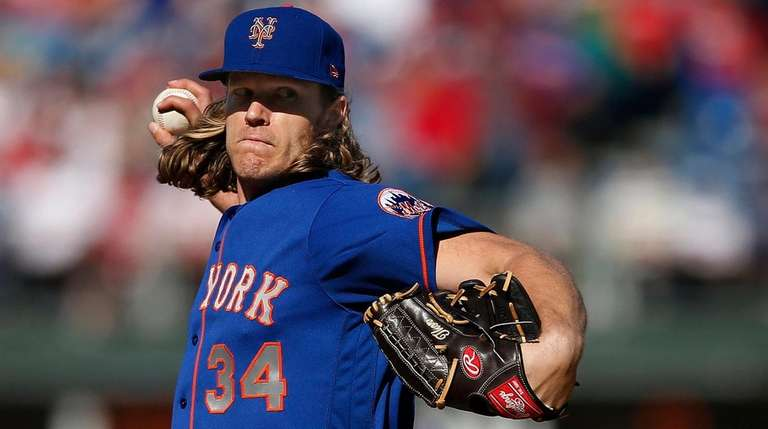 Noah Syndergaard of the Mets delivers a pitch