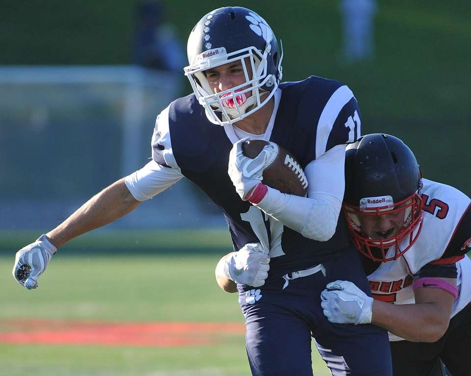 Max Napoli of Northport fights for yards as