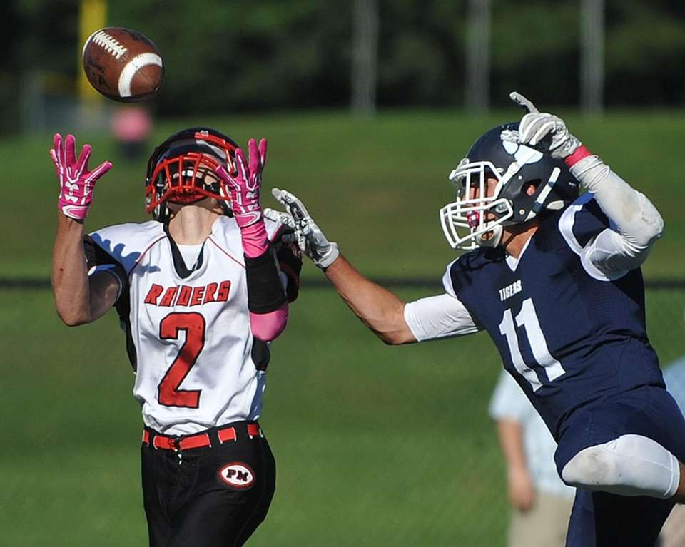 Kevin Hillman of Patchogue-Medford, left, catches a pass