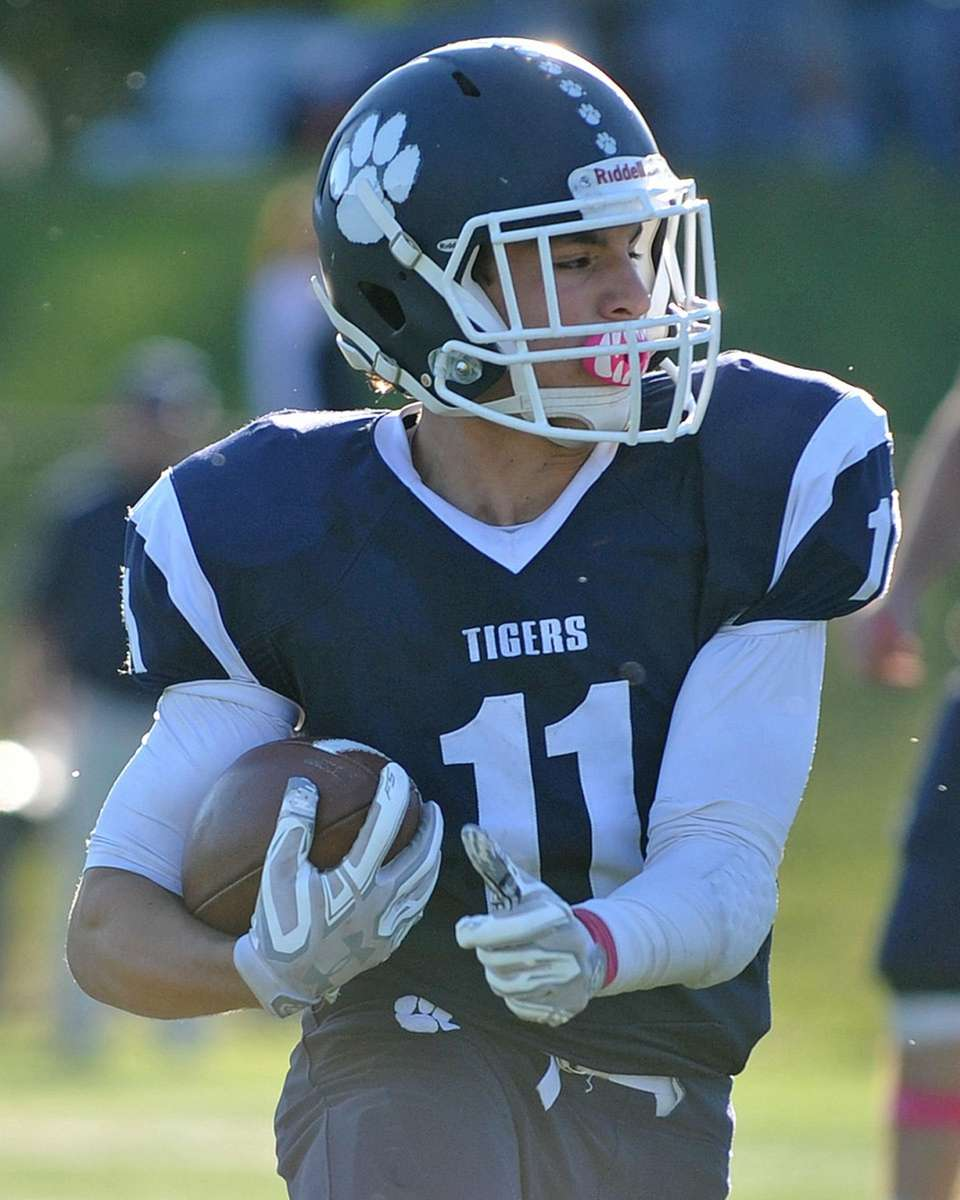Max Napoli of Northport rushes for a 10-yard
