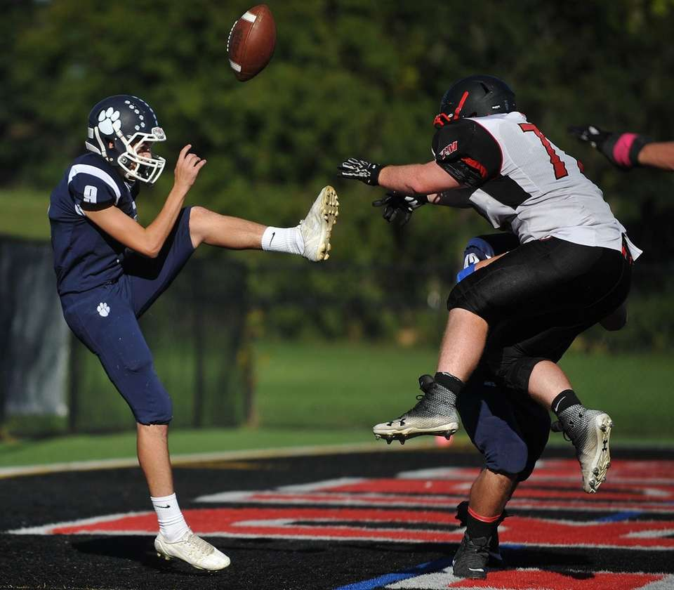 Tate Atherton of Northport, left, has a punt