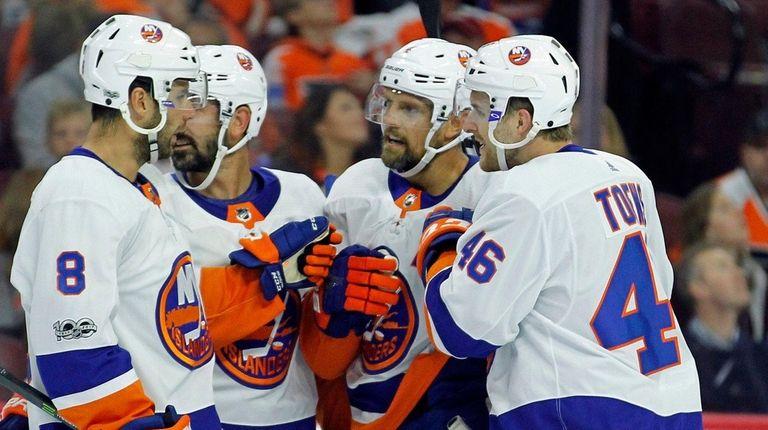 From left, the Islanders' Steve Bernier, Cal Clutterbuck,