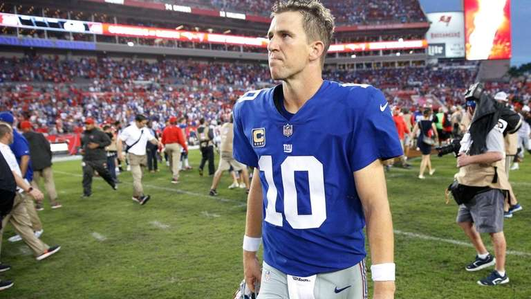 Eli Manning of the Giants reacts as he
