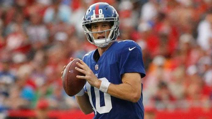 Eli Manning of the Giants looks for an